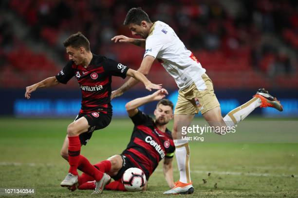 Jason Hoffman of the Jets competes for the ball against Brendan Hamill and Jordan O'Doherty of the Wanderers during the round five A-League match...