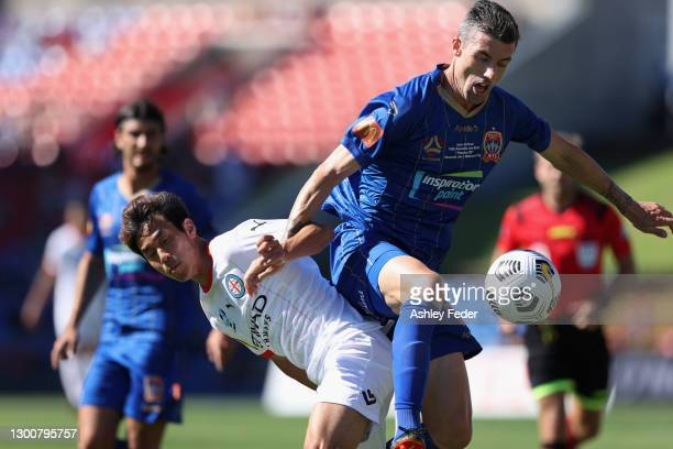 Jason Hoffman of the Jets contests the ball against Naoki Tsubaki of Melbourne City during the A-League match between the Newcastle Jets and...