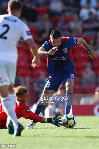 Jason Hoffman of the Jets contests the ball with Lewis Italiano of the Phoenix during the round 17 ALeague match between the Newcastle Jets and...