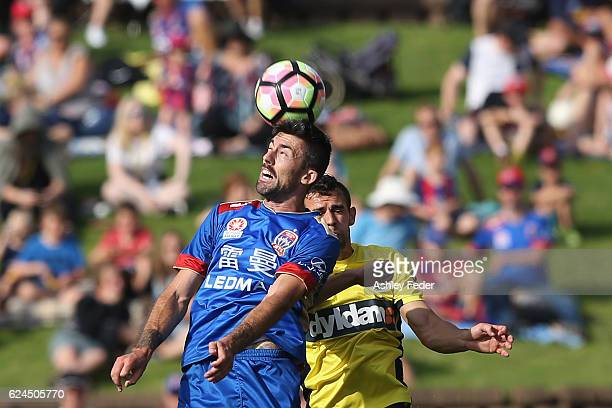 Jason Hoffman of the Jets heads the ball ahead of the Mariners defence during the round seven ALeague match between the Newcastle Jets and the...