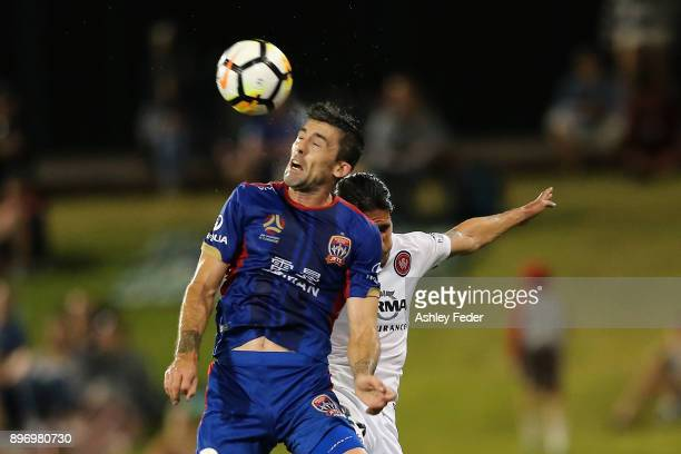 Jason Hoffman of the Jets heads the ball during the round 12 ALeague match between the Newcastle Jets and the Western Sydney Wanderers at McDonald...