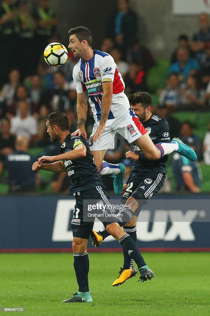 Jason Hoffman of the Jets (C) heads the ball during the round 13 A-League match between the Melbourne Victory and the Newcastle Jets at AAMI Park on December 29, 2017 in Melbourne, Australia.
