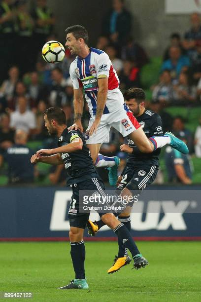 Jason Hoffman of the Jets heads the ball during the round 13 ALeague match between the Melbourne Victory and the Newcastle Jets at AAMI Park on...