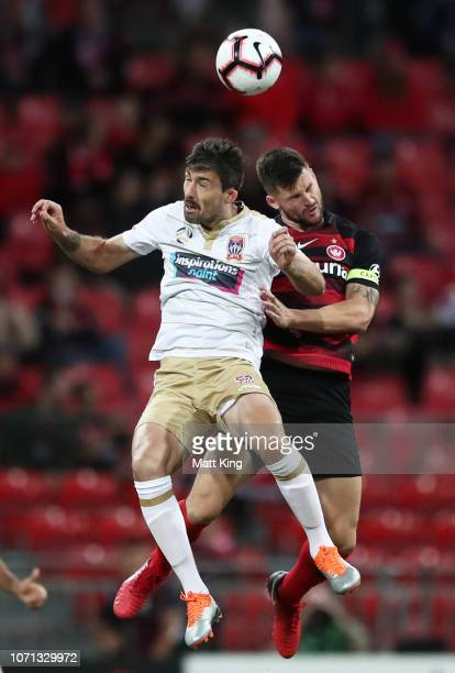 Jason Hoffman of the Jets is challenged by Brendan Hamill of the Wanderers during the round five A-League match between the Western Sydney Wanderers...