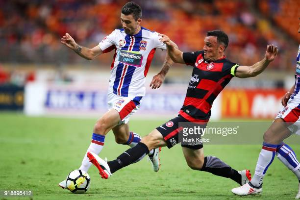 Jason Hoffman of the Jets is tackled Mark Bridge of the Wanderers during the round 20 ALeague match between the Western Sydney Wanderers and the...