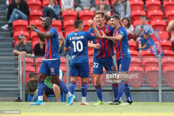 Jason Hoffman of the Newcastle Jets celebrates a goal with team mates during the Round 5 A-League match between the Newcastle Jets and the Perth...
