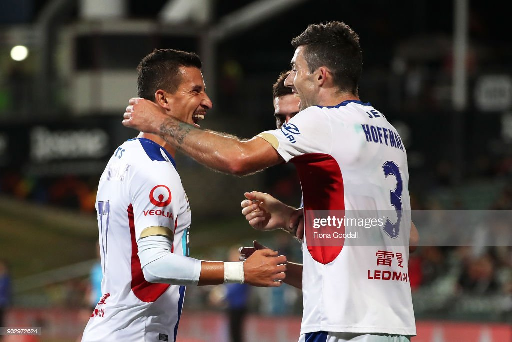 Jason Hoffman (R) of the Newcastle Jets scores a goal during the round 23 A-League match between the Wellington Phoenix and the Newcastle Jets at QBE Stadium on March 17, 2018 in Auckland, New Zealand.