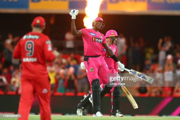 Jason Holder and Ben Manenti of the Sixers celebrate winning the Big Bash League match between the Melbourne Renegades and the Sydney Sixers at...