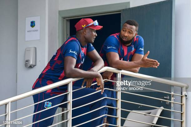 Jason Holder and Kieron Pollard of West Indies during the abandoned 2nd ODI between West Indies and Australia at Kensington Oval, Bridgetown,...
