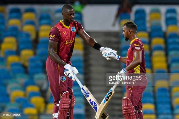 Jason Holder and Nicholas Pooran of West Indies 50 runs partnership during the 2nd ODI between West Indies and Australia at Kensington Oval,...