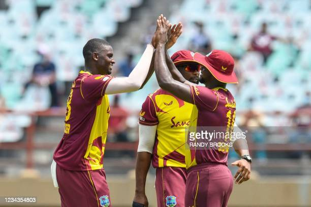 Jason Holder and Romario Shepherd of the West Indies celebrate the dismissal of Sohaib Maqsood of Pakistan during the 2nd T20I match between the West...