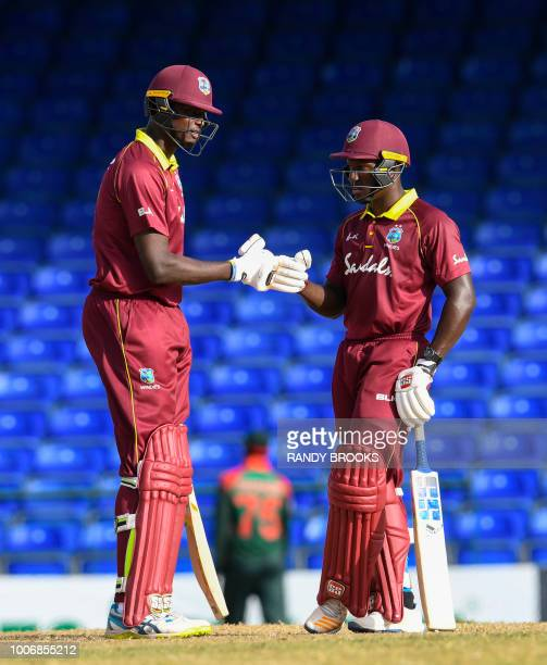 Jason Holder and Rovman Powell of West Indies celebrate during the 3rd and final ODI match between West Indies and Bangladesh at Warner Park...