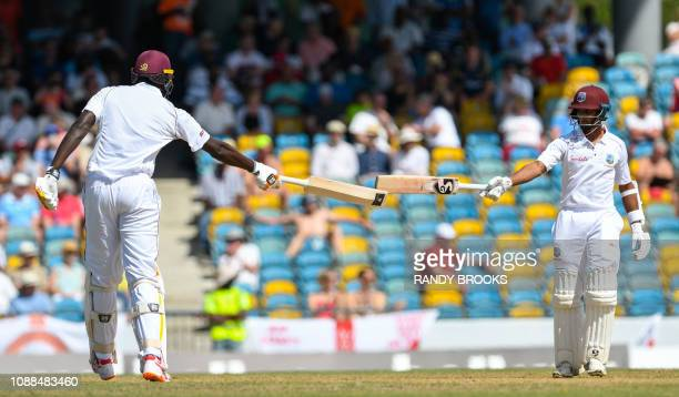 Jason Holder and Shane Dowrich of West Indies 100 partnership during day 3 of the 1st Test between West Indies and England at Kensington Oval,...