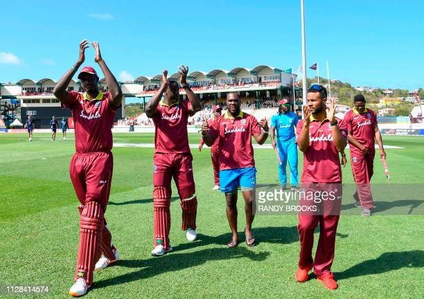 Jason Holder Carlos Brathwaite Ashley Nurse Chris Gayle Shai Hope and Oshane Thomas of West Indies wave to supporters at the end of the 5th and final...