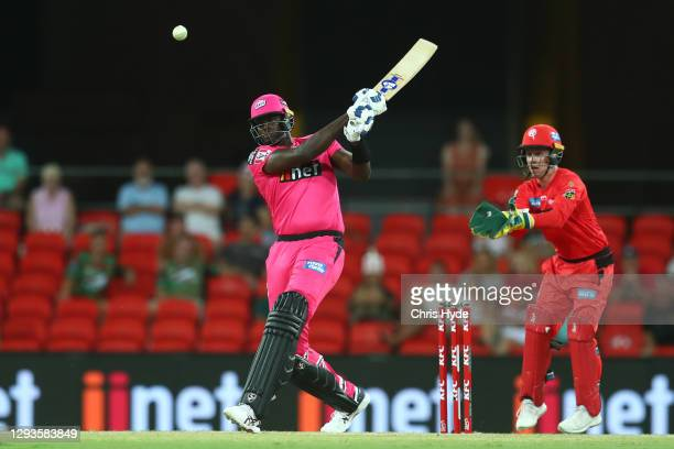 Jason Holder of the Sixers bats during the Big Bash League match between the Melbourne Renegades and the Sydney Sixers at Metricon Stadium, on...