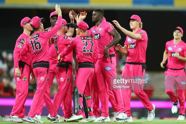 Jason Holder of the Sixers celebrates with team mates after dismissing Andre Fletcher of the Stars during the Big Bash League match between Sydney...
