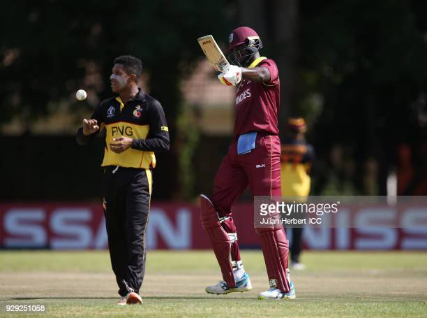 Jason Holder of The West Indies acknowledges his hlf century during The Cricket World Cup Qualifier between The West Indies and Papua New Guinea at...
