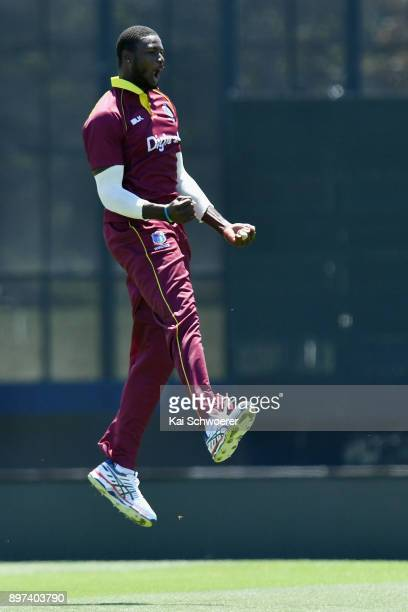 Jason Holder of the West Indies celebrates after dismissing Ross Taylor of New Zealand during the One Day International match between New Zealand and...