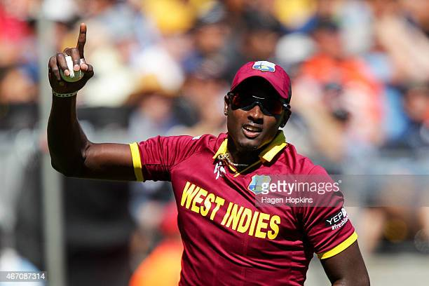 Jason Holder of the West Indies celebrates after taking a catch to dismiss Brendon McCullum of New Zealand during the 2015 ICC Cricket World Cup...