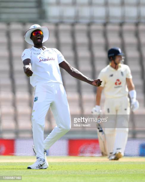 Jason Holder of the West Indies celebrates catching out Joe Denly of England during day four of the 1st #RaiseTheBat Test match at The Ageas Bowl on...