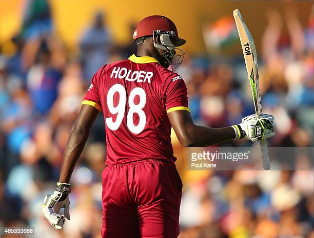 Jason Holder of the West Indies celebrates his half century during the 2015 ICC Cricket World Cup match between India and the West Indies at WACA on...
