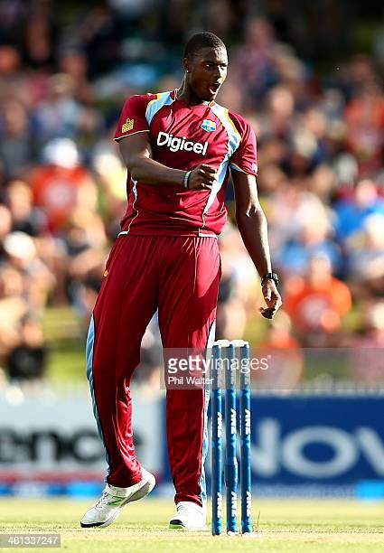 Jason Holder of the West Indies celebrates his wicket of Kane Williamson of New Zealand during game five of the One Day International Series between...