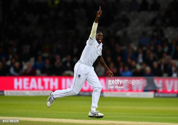 Jason Holder of the West Indies celebrates taking the wicket of Joe Root of England during day one of the 3rd Investec Test Match between England and...