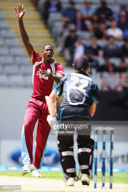 Jason Holder of the West Indies celebrates the wicket of Kane Williamson of New Zealand during the first One Day International match between New...