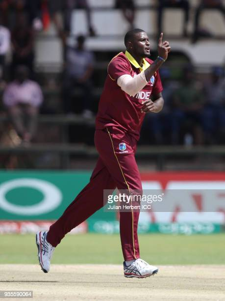 Jason Holder of the West Indies celebrates the wicket of Matthew Cross of Scotland during The ICC Cricket World Cup Qualifier between the West Indies...