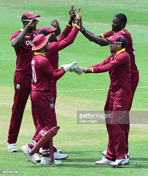 Jason Holder of the West Indies celebrates the wicket of Usman Khawaja of Australia with his team mates during the TriNation Series Oneday...