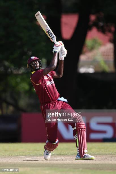 Jason Holder of The West Indies hits out during The Cricket World Cup Qualifier between The West Indies and Papua New Guinea at The Old Hararians on...