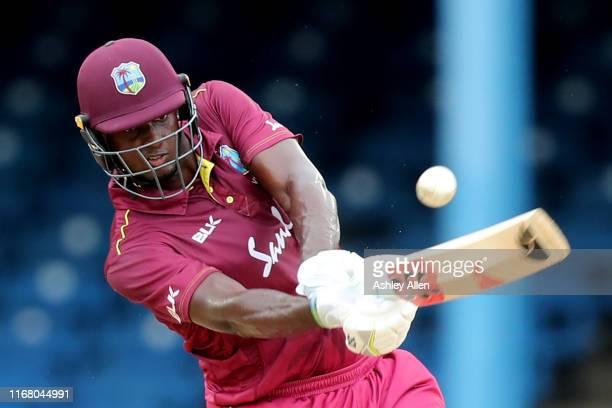 Jason Holder of the West Indies keeps his eye on the ball during the third MyTeam11 ODI between the West Indies and India at the Queen's Park Oval on...