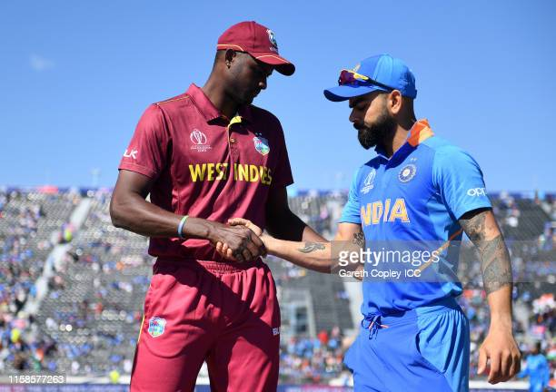 Jason Holder of West Indies and Virat Kohli of India shake hands during the Group Stage match of the ICC Cricket World Cup 2019 between West Indies...