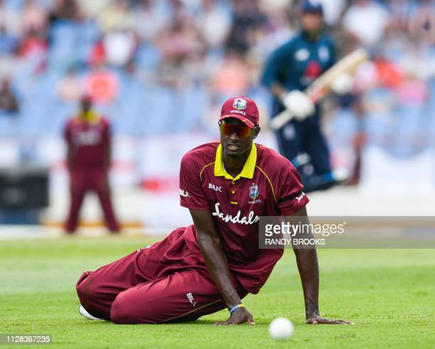 Jason Holder of West Indies attempts to stop Alex Hales of England from scoring during the 5th and final ODI between West Indies and England at...