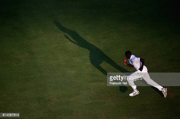 Jason Holder of West Indies bowls during Day One of the First Test between Pakistan and West Indies at Dubai International Cricket Ground on October...