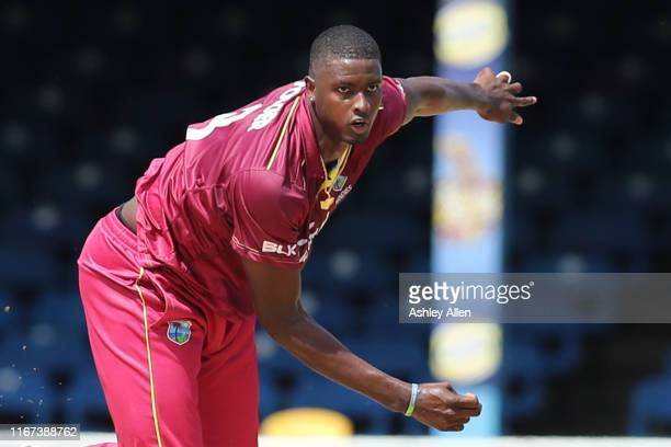 Jason Holder of West Indies bowls during the second MyTeam11 ODI between the West Indies and India at the Queen's Park Oval on August 11, 2019 in...