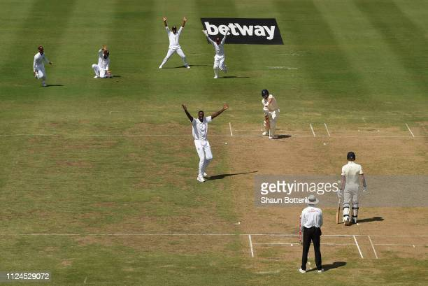 Jason Holder of West Indies celebrates after taking the wicket of Joe Root of England during Day Two of the First Test match between England and West...