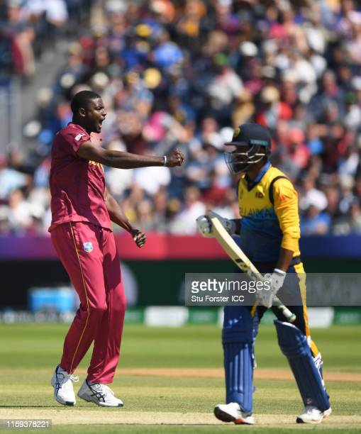 Jason Holder of West Indies celebrates after taking the wicket of Dimuth Karunaratne of Sri Lanka during the Group Stage match of the ICC Cricket...