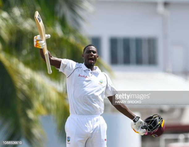 Jason Holder of West Indies celebrates his century during day 3 of the 1st Test between West Indies and England at Kensington Oval, Bridgetown,...