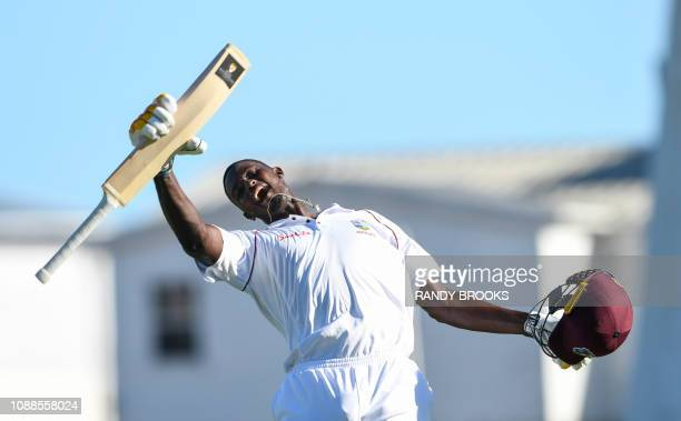 Jason Holder of West Indies celebrates his double century during day 3 of the 1st Test between West Indies and England at Kensington Oval Bridgetown...