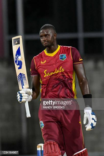 Jason Holder of West Indies celebrates his half century during the 2nd ODI between West Indies and Australia at Kensington Oval, Bridgetown,...