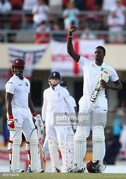 Jason Holder of West Indies celebrates reaching his century alongside Kemar Roach during day five of the 1st Test match between West Indies and...