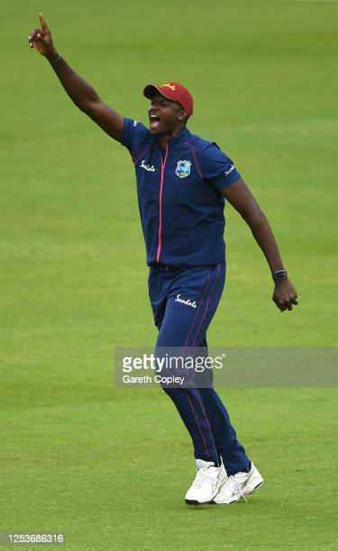 Jason Holder of West Indies celebrates taking the catch of Kraigg Brathwaite during Day Three of a West Indies Warm Up match at Old Trafford on July...