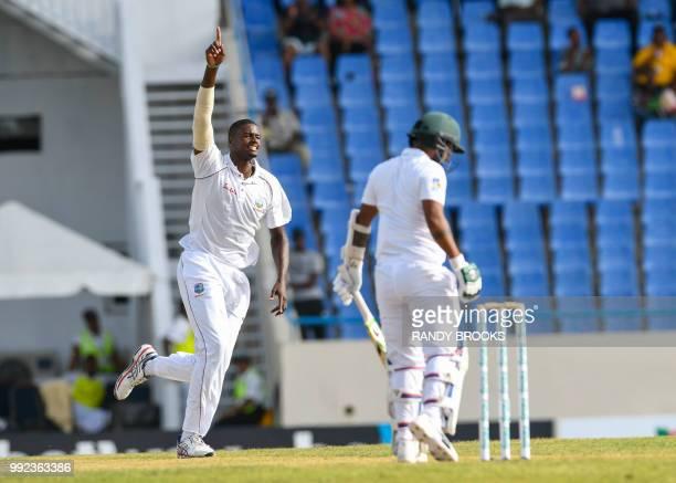 Jason Holder of West Indies celebrates the dismissal of Liton Das of Bangladesh during day 2 of the 1st Test between West Indies and Bangladesh at...