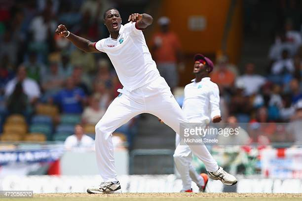 Jason Holder of West Indies celebrates trapping Chris Jordan of England lbw during day three of the 3rd Test match between West Indies and England at...