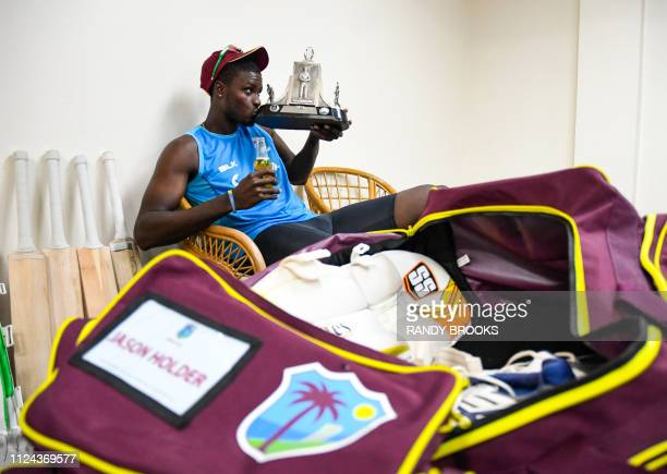 Jason Holder of West Indies holds the Wisden trophy in the dressing room at the end of day 4 of the 3rd and final Test between West Indies and...