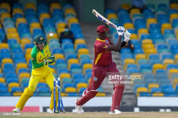 Jason Holder of West Indies is bowled by Adam Zampa and Alex Carey of Australia during the 3rd and final ODI between West Indies and Australia at...