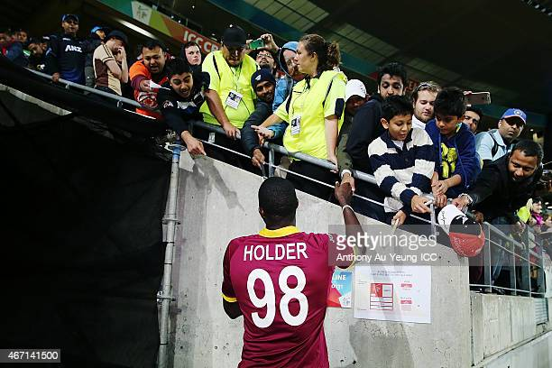 Jason Holder of West Indies signs autographs for the fans after the 2015 ICC Cricket World Cup match between New Zealand and the West Indies at...