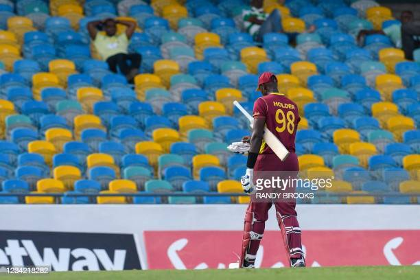 Jason Holder of West Indies walks off the field dismissed by Adam Zampa of Australia during the 3rd and final ODI between West Indies and Australia...