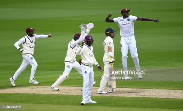 Jason Holder, Shane Dowrich and Jermaine Blackwood of West Indies celebrate the wicket of Rory Burns of England during Day One of the 2nd Test Match...